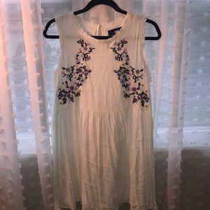 Boutique dress with floral appliqués